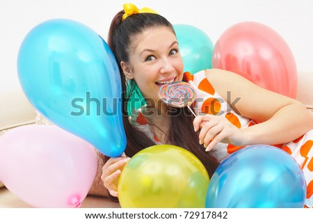 stylish girl with ballons and candy