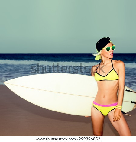 Stylish Girl with white Surf board on the beach - stock photo