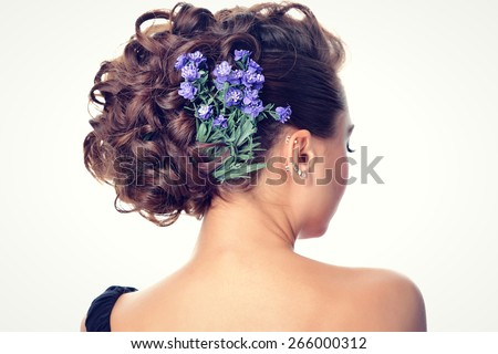 stylish glamor girl with beautiful hairstyle and bright makeup flowers in the hair - stock photo