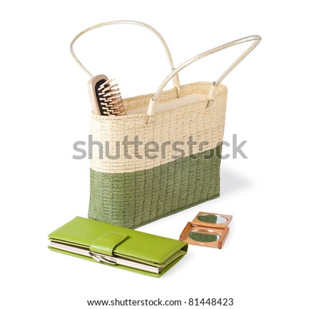 stylish handbag with purse hairbrush and mirror isolated on white background - stock photo