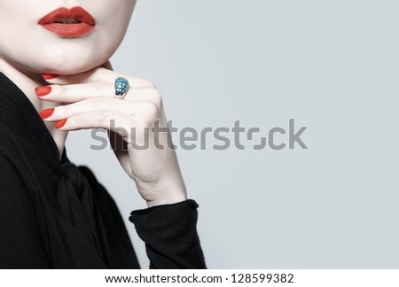 Stylish lady in studio with luxurious jewelry - stock photo
