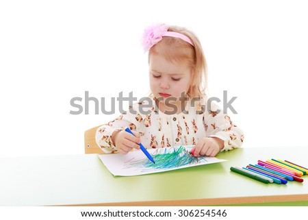Stylish little blonde girl with a pink bow on his head draws with markers on paper. The girl is dressed in a white blouse and brown shorts-Isolated on white background - stock photo