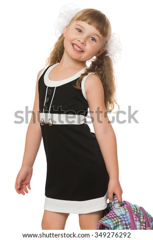 Stylish little girl with long bushy tails and short bangs on the head. Girl is dressed in a simple short black dress in which she goes to school . closeup - Isolated on white background.The concept of - stock photo