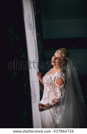 stylish luxury gorgeous blonde bride posing on the background hotel room. Bride with crown. Top view.  - stock photo