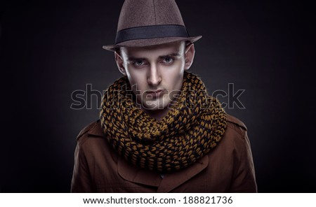 Stylish man in a hat and coat. Traveler