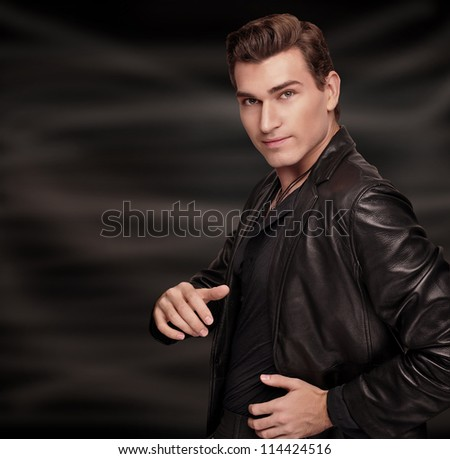 Stylish man in black suit - stock photo