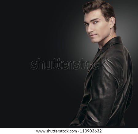 Stylish man in black suit.	Portrait of a handsome man