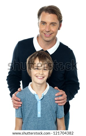 Stylish man in blue pullover posing with his smiling son. Isolated over white. - stock photo