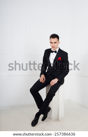 Stylish man in elegant black suit - stock photo
