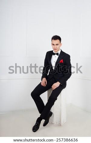 Stylish man in elegant black suit - stock photo
