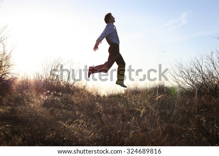 Stylish Man is Flying in the Sky with Sun Illuminating the Entire Area