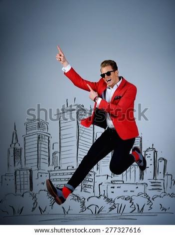 Stylish man jumping against city panorama drawing - stock photo