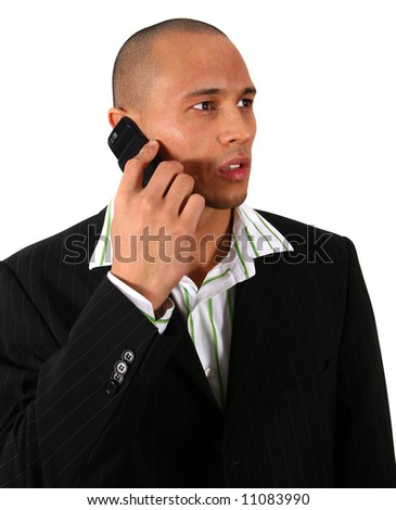 Stylish Man On Cell Stylish young man in suit is using his cell phone. Isolated over white. - stock photo
