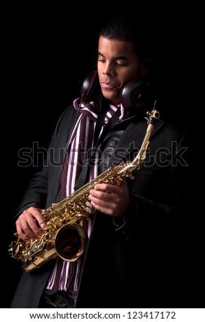 Stylish man playing the saxophone - stock photo