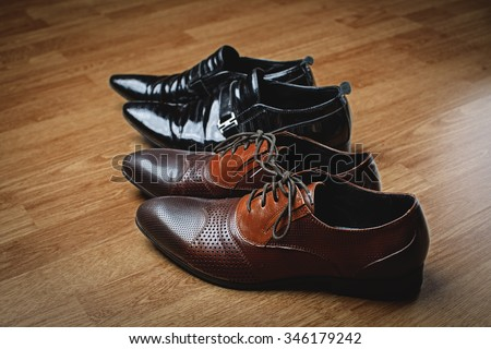 stylish men's black and brown shoes - stock photo