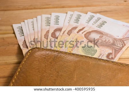 Stylish Menu0027s Purse With Money On Wood Background