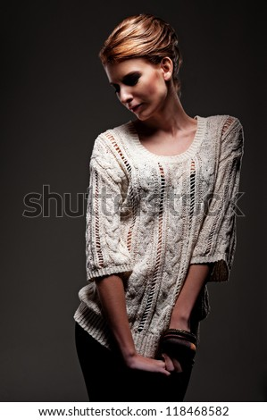 stylish model posing over dark background - stock photo