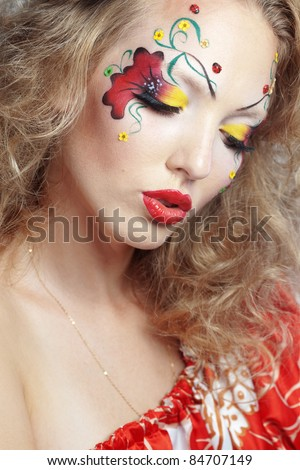 Stylish model with face paint