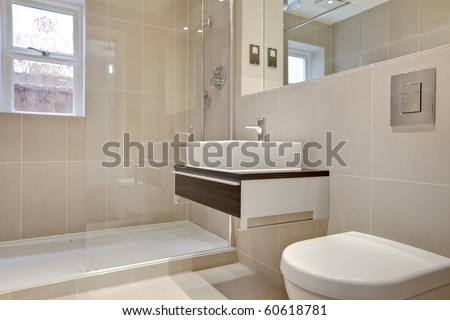 Stylish modern bathroon suite with basin, cabinet, wc and shower cubicle
