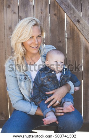 Stylish mother and son with matching jean outfits