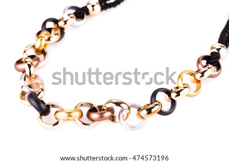 Stylish necklace with colorful rings isolated on white background.