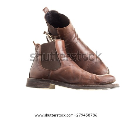 Stylish old chelsea leather boots. Isolated on a white background - stock photo