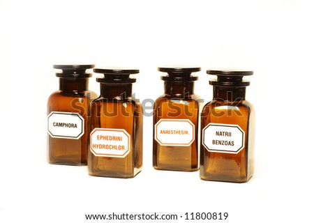 Stylish pharmacy bottles, isolated - stock photo