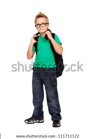 Stylish schoolboy with a bag and headphones full length portrait
