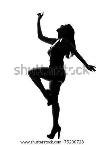 stylish silhouette caucasian beautiful woman dancing happy  full length on studio isolated white background - stock photo