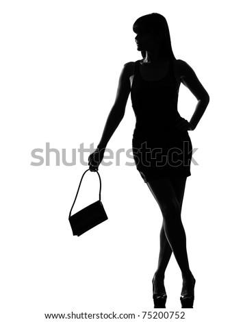 stylish silhouette caucasian beautiful woman holding purse waiting full length on studio isolated white background - stock photo