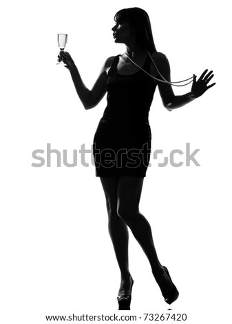 stylish silhouette caucasian beautiful woman partying drinking champagne flute glass cocktail full length on studio isolated white background - stock photo