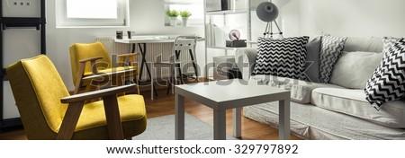 Stylish sitting place in contemporary studio flat - stock photo