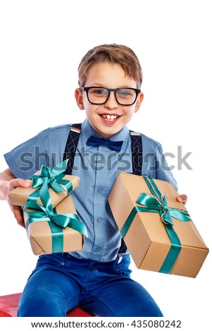 Stylish small boy in glasses received a gift. He is smiling and looking in the camera. Isolated on a white background. - stock photo