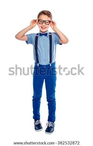Stylish small boy with glasses. He is smiling and looking in the camera. Isolated on a white background. - stock photo