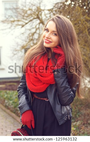 stylish smiling girl outdoor portrait - stock photo