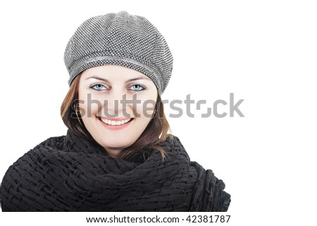 Stylish smiling young woman in grey hat and knitted black scarf isolated on white with copy space - stock photo