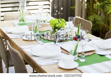 Stylish table setting for outdoor dining - stock photo