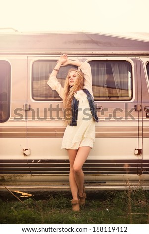 stylish vintage hipster picture beautiful girl on a background of the bus on a sunny day - stock photo