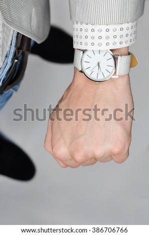 stylish white wristwatches on the hand businessman