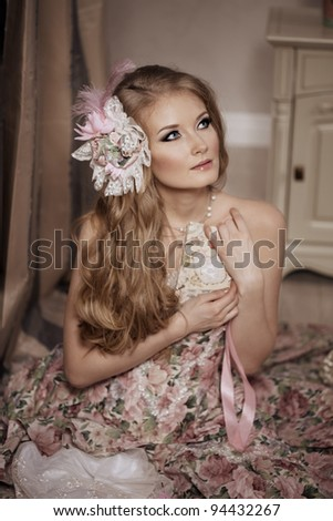 Stylish woman in a vintage dress in a luxurious interior - stock photo