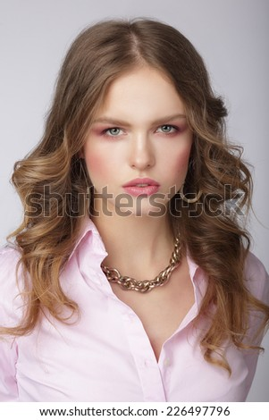 Stylish Woman in Pink Blouse with Massive Chainlet - stock photo