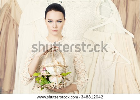 Stylish Woman on Background of Clothing and Accessories - stock photo