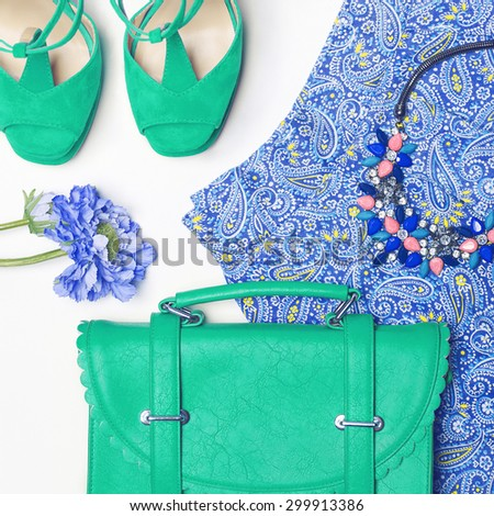 Stylish woman outfit in blue and green colors on white background - stock photo