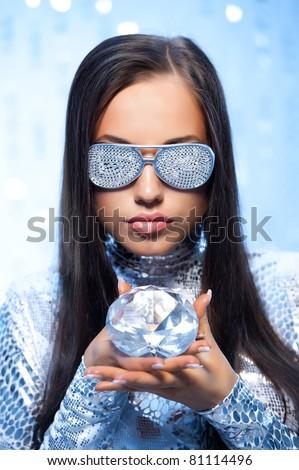Stylish woman with a diamond - stock photo