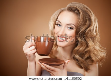 Stylish woman with an aromatic coffee in hands