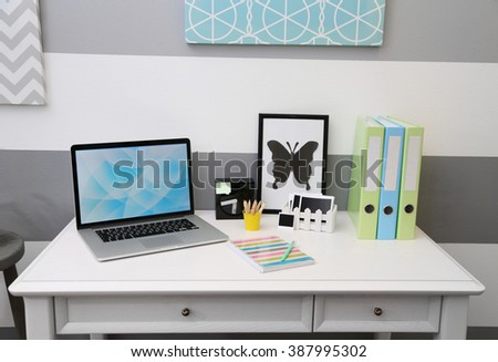 Stylish workplace with laptop at home, closeup