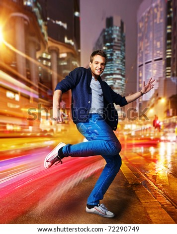 Stylish young dancer in the night city - stock photo