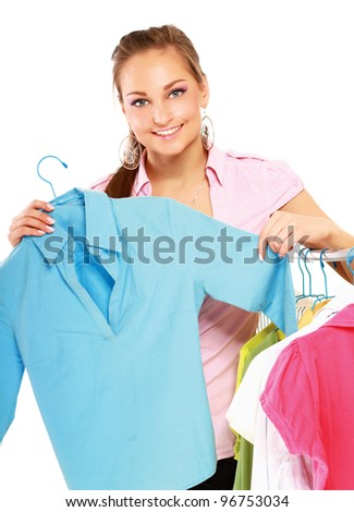 Stylish young girl trying on clothes in clothing store isolated - stock photo
