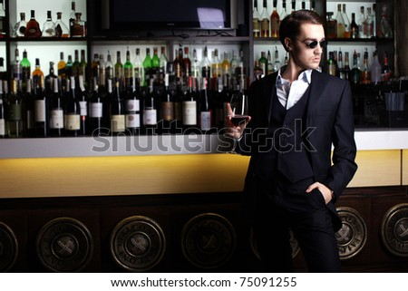 Stylish young man in a bar - stock photo