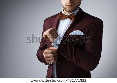 Stylish young man in suit and tie. Business style. Fashionable image. Office worker. Sexy man standing and looking at the camera. Ceremonial clothes. Secular person. Hipster look - stock photo